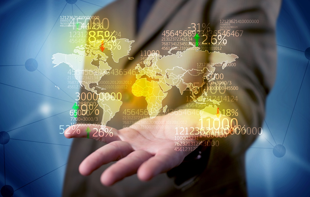 An elegant analytics person holding map of the world in its hand with numbers, statistics in front of blue background concept