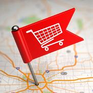 Shopping Concept - Small Flag on a Map Background with Selective Focus.