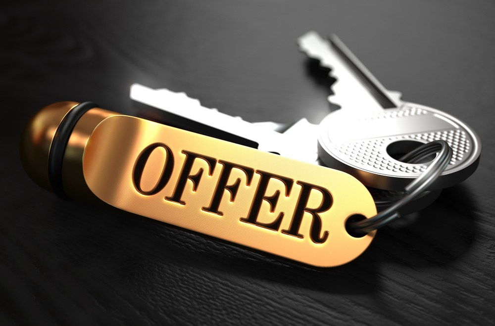 Keys with Word Offer on Golden Label over Black Wooden Background. Closeup View, Selective Focus, 3D Render.